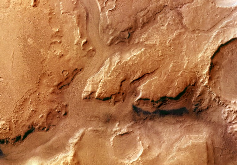 Reull Vallis is an outflow channel that extends 1500 kilometers across Promethei Terra in the direction of Hellas Basin. Mars Express took this imageon May 29, 2004.