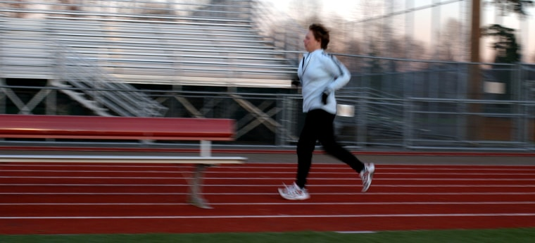 Before each workout, I start with a warm-up mile. No, I did not run into the bench but I did want to sit down on it.