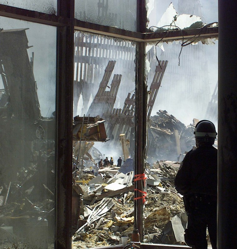 NEW YORK CITY POLICE OFFICER LOOKS AT WORLD TRADE CENTER WRECKAGE