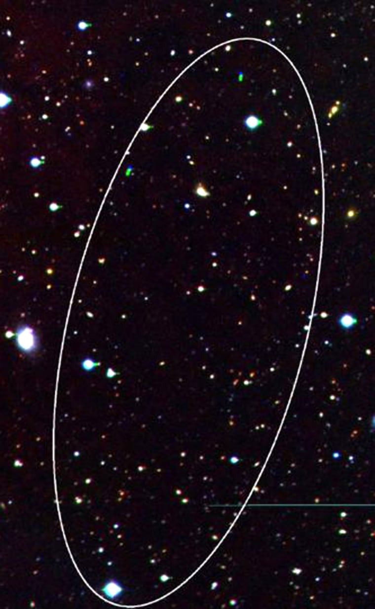 The ellipse shows the region of sky where the dark galaxy was found.