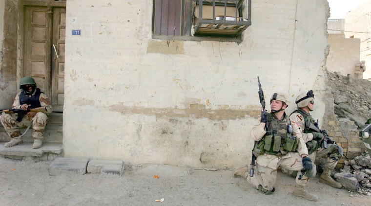Iraqi Army And U.S. Military Patrol Together In The Haifa Street Area of Ba