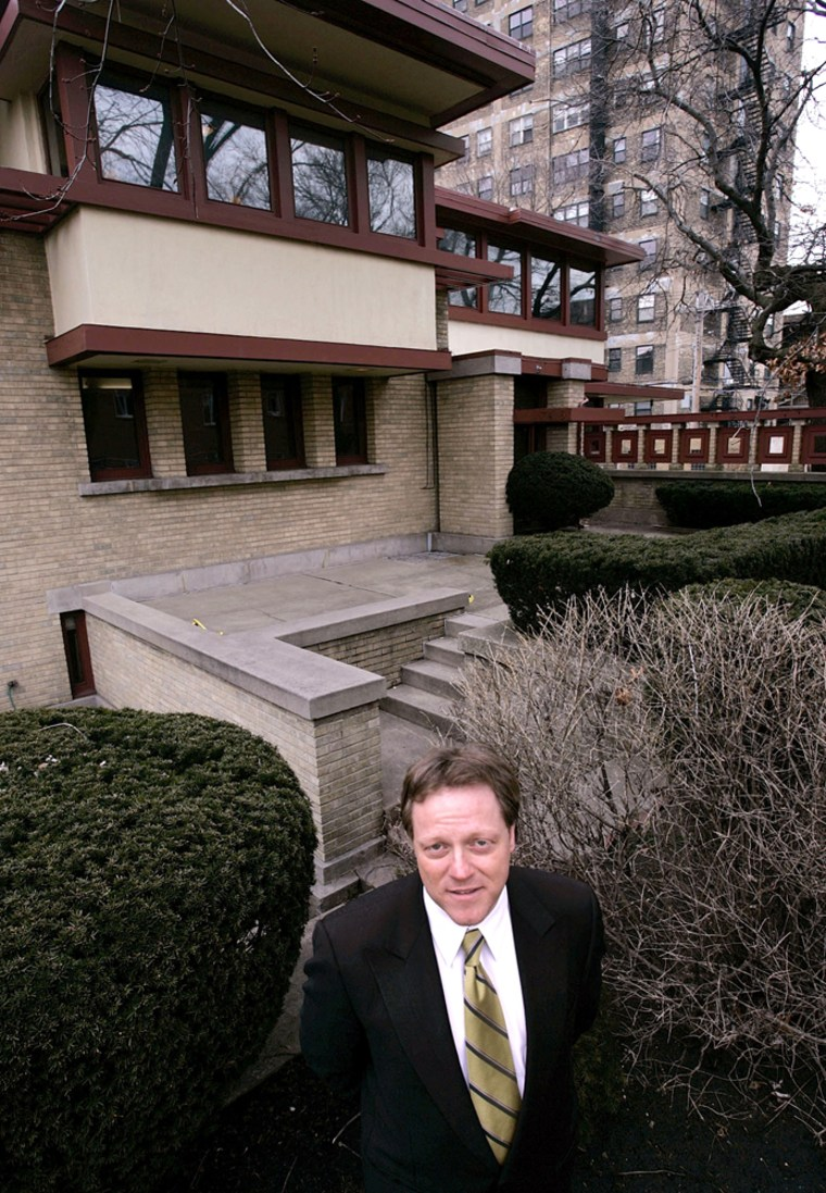 Frank Diliberto, whose company is handling the auction of the Emil Bach House, stands in front of the Prairie-style home designed by Frank Lloyd Wright.