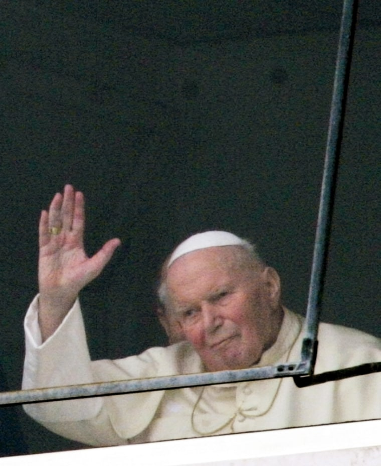 Pope John Paul II waves to well-wishers outside his window at the Gemelli hospital in Rome on Sunday.
