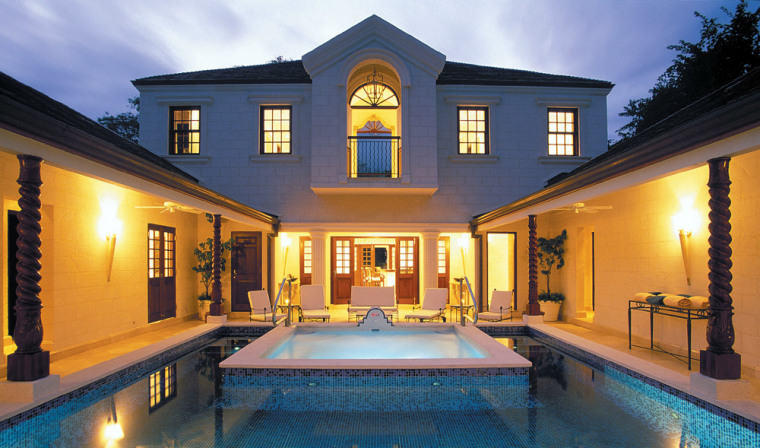 The Villa at Sandy Lane is a butler-serviced compound built around a courtyard pool.