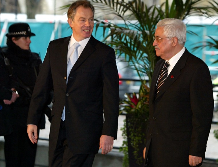 Britain's Prime Minister Tony Blair greets Palestinian leader Mahmoud Abbas in London on Tuesday.