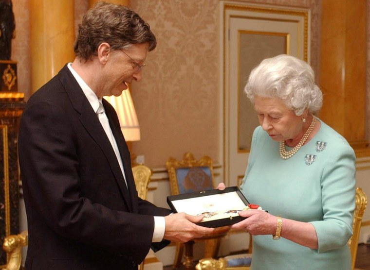 Britain's Queen Elizabeth II presents Microsoft's Bill Gates with his honorary knighthood at Buckingham Palace in London, Wednesday.