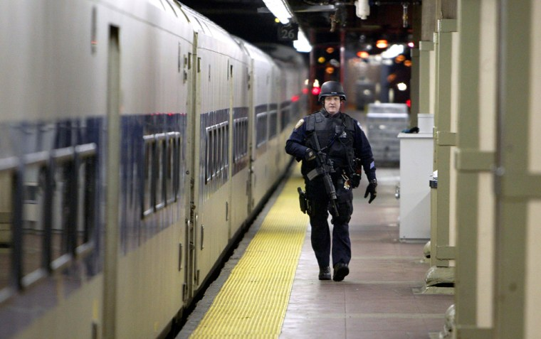 A heavily armed police officer patrols the tracks below Grand Central Station in New York City earlier this year.