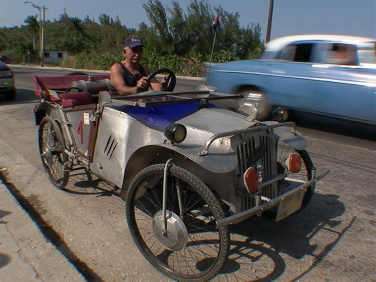 Juan Martinez Rangel drives his prized possession, a car assembled over a 20-year period witha pile of scrap metal and junkyard parts.
