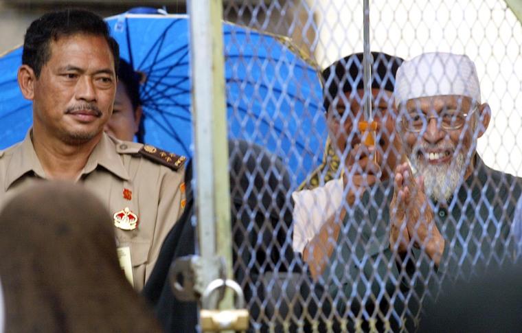 Indonesian Muslim cleric Abu Bakar Bashir greets his supporters at the Cipinang prison in Jakarta