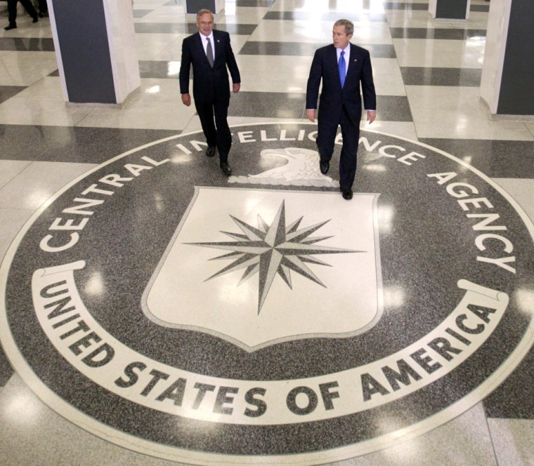 U.S. President George W. Bush and CIA Director Goss walk in the lobby of the CIA headquarters in Langley