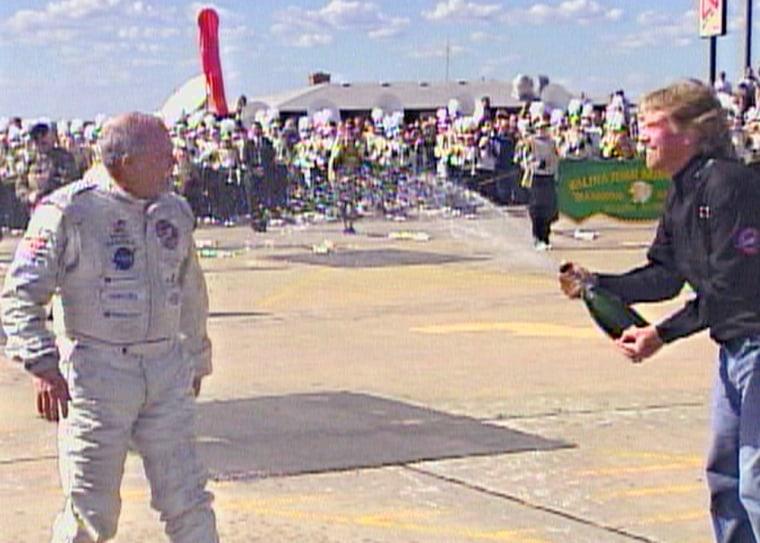 Sir Richard Branson sprays Steve Fossett with champagne shortly after Fossett landed the GlobalFlyer in Salina, Kan., on Thursday.