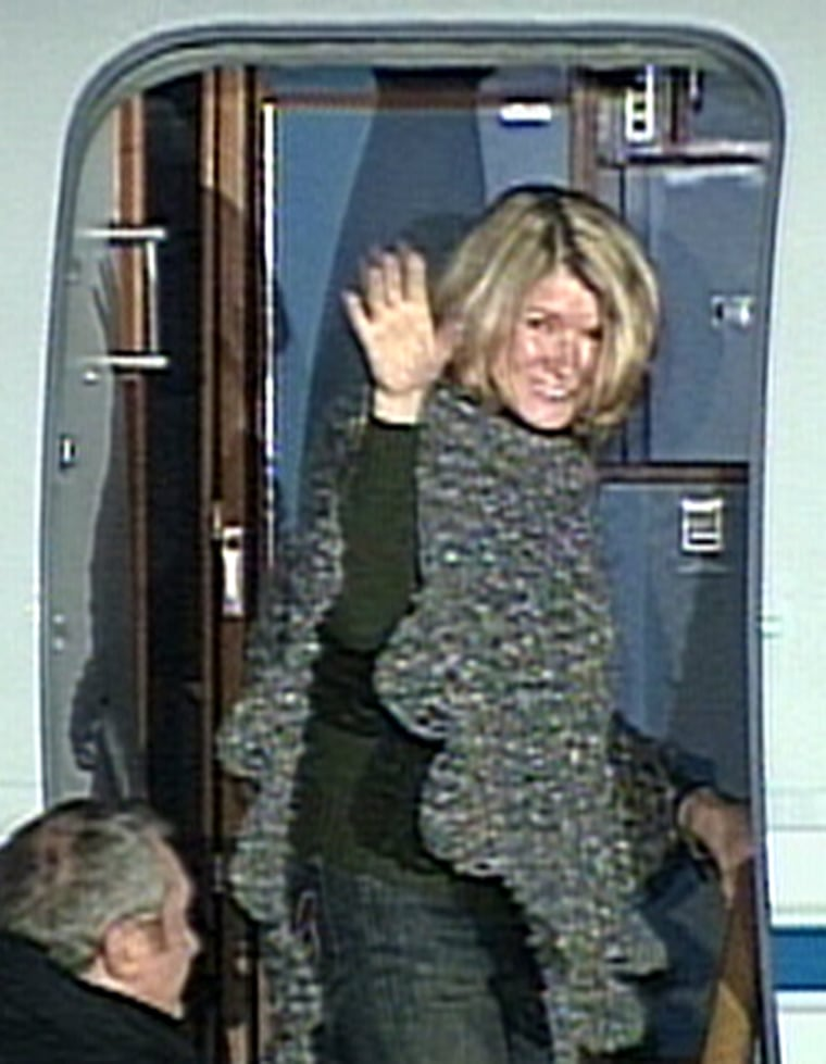 Martha Stewart boarding plane just after her release from prison.