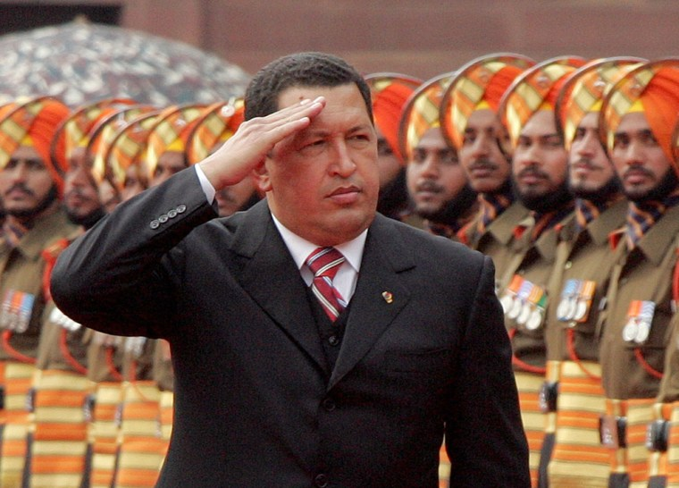 Venezuela's President Hugo Chavez inspects an honour guard during his ceremonial welcome at the presidential palace in New Delhi