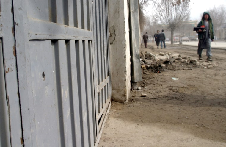 A fresh hole caused by a bullet is seen on the door of a building in Kabul