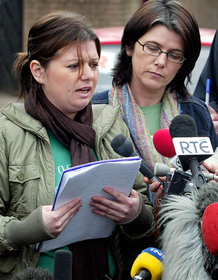Robert McCartney's sisters Claire, left, and Catherine speak to the media Wednesday during a news conference in East Belfast, Northern Ireland.