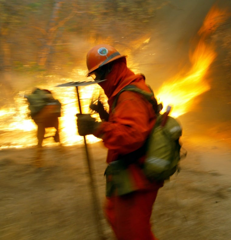 Firefighters are preparing for a nasty fire season likely to feature scenes like this one from a July 18, 2004, blaze near Santa Clarita, Calif.