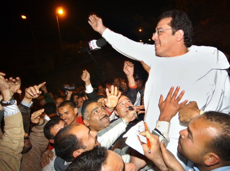 Egyptian opposition leader Ayman Nour greets supporters of the Tomorrow Party in Cairo on Saturday. Nour was subject to a controversial arrest in January on allegations he forged documents to register the party.
