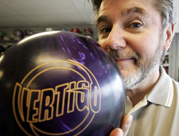 Joe Cerar, owner of the Bowlers Pro Shop in Milwaukee, smells an amaretto scented bowling ball in his shop.