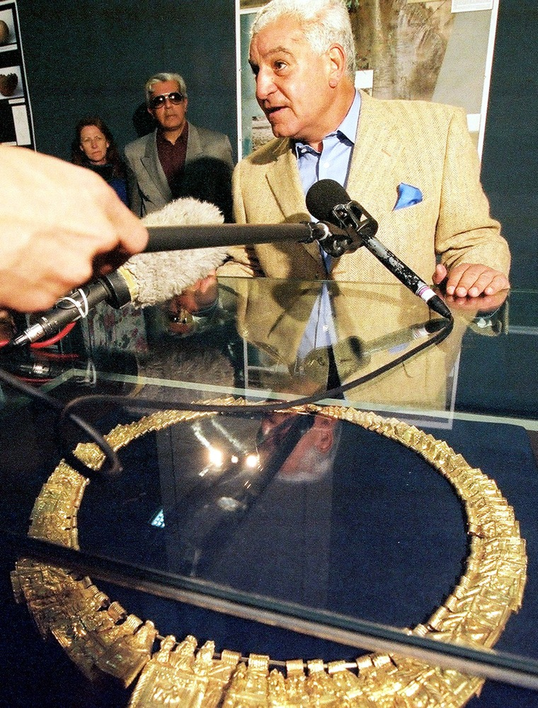 Zahi Hawass, chief of Egypt's Supreme Council of Antiquities, on Tuesday shows off one of the stunning gold necklaces previously hidden from view at the Egyptian Museum.
