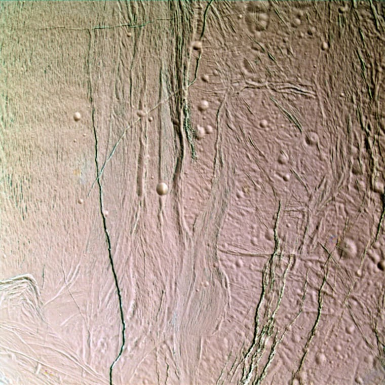 This false-color, close-up look at Enceladus yields new insight into the different processes that have shaped the moon's icy surface. Extending through the center of this image, a system of two-mile (three-kilometer) wide rifts and 12-mile (20-kilometer) wide lanes of grooved terrain separate two distinct geological provinces on Enceladus. To the right of the boundary is older, cratered terrain.