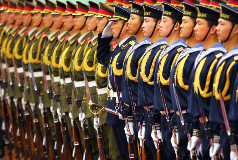 Chinese military honour guards stand in a formation during a ceremony in Beijing