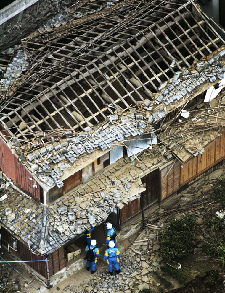 RESCUE WORKERS COLLAPSED HOUSE ON GENKAI ISLAND