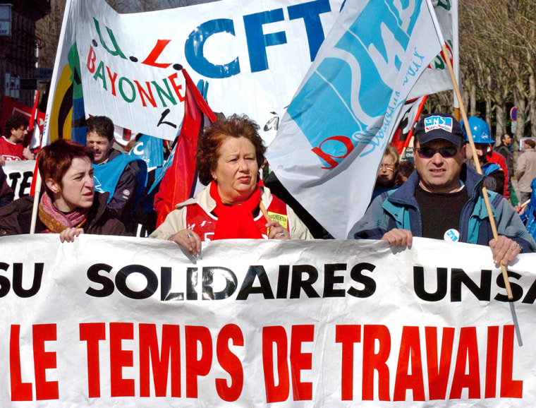 "Demonstrators in southern France earlier this month gathered to defend the 35-hour workweek. Introduced under the Socialists, ""les 35 heures"" have been a boon for some but, critics argue, a big drain on the economy."