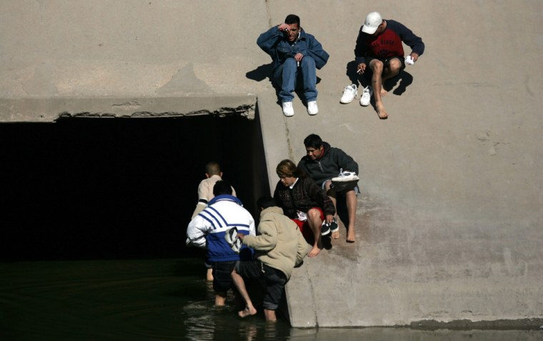 People prepare to cross illegally into the United States through a tunnel along the Rio Grande in the border city of Ciudad Juarez, Mexico, in January. The undocumented U.S. immigrant population surged last year, according to a report released Monday.