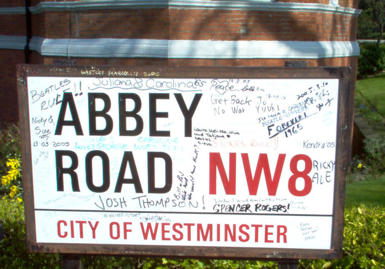 Devoted fans pay their respects to the Beatles by autographing a sign outside the world-famous recording studio.