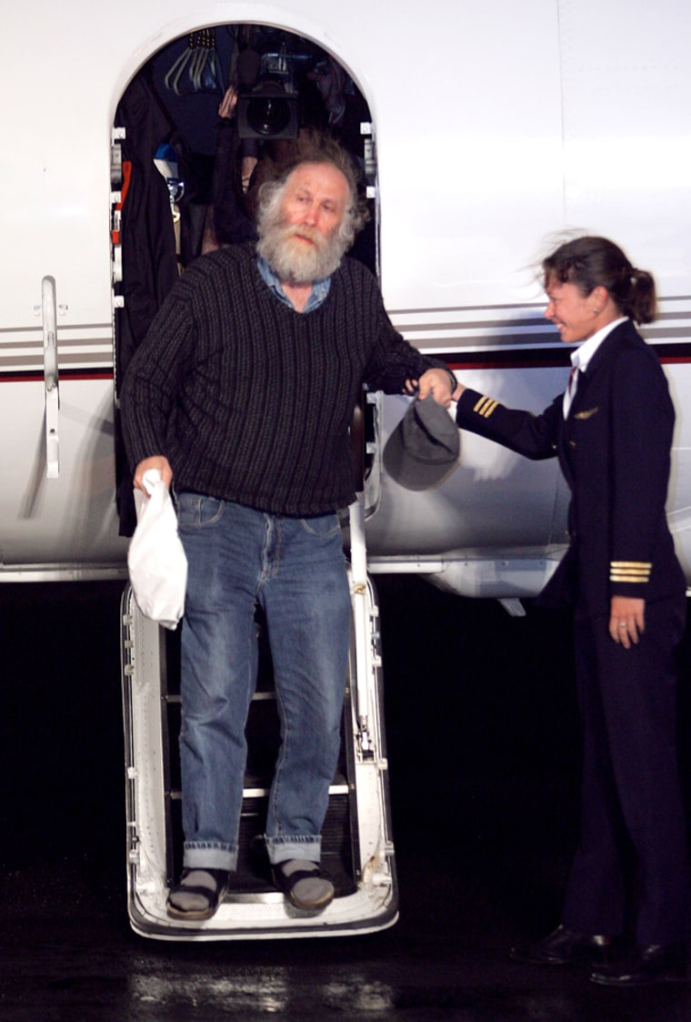 Chess legend Bobby Fischer disembarks from a private jet in Reykjavik, Iceland, on Thursday, after accepting an offer of citizenship.