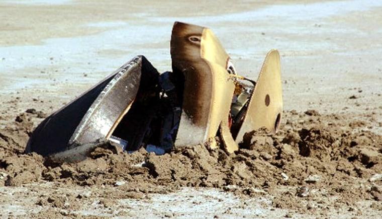 Genesis space capsule embedded in the earth after crashing in the Utah desert