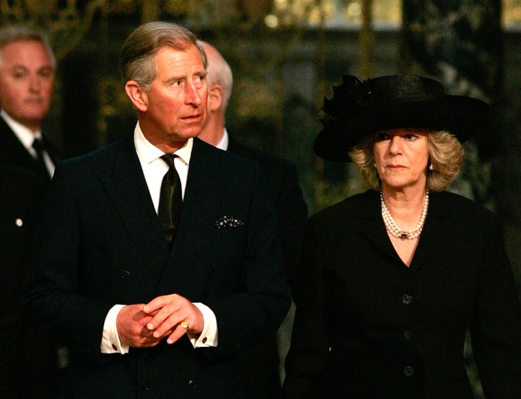 Prince Charles and Camilla Parker-Bowles attend a service in memory of Pope John Paul II at London's Westminster Cathedral