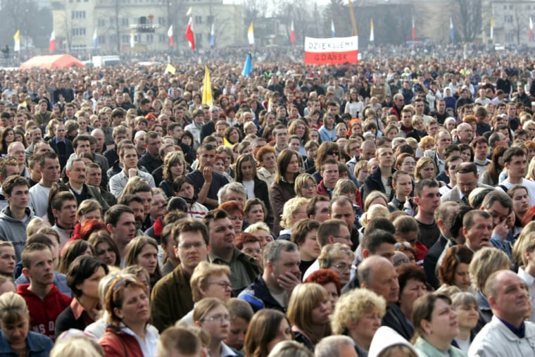 Crowds in Krakow take part in an open-air Mass in commemoration of Pope John Paul IIon Friday.