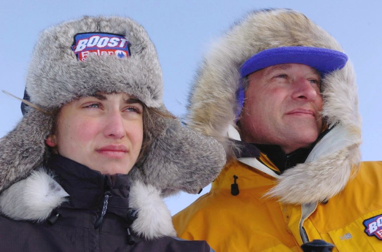 Alicia Hempleman-Adams, 15, stands with her father, David Hempleman-Adams, in the Canadian Arctic after she bettered his time in crossing Baffin Island.