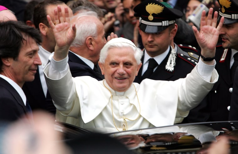 Pope Benedict XVI greets well-wishers in front of his formerhome in Rome on Wednesday. Liberal and conservative Catholics in the United States are divided over the new pope's orthodox views.