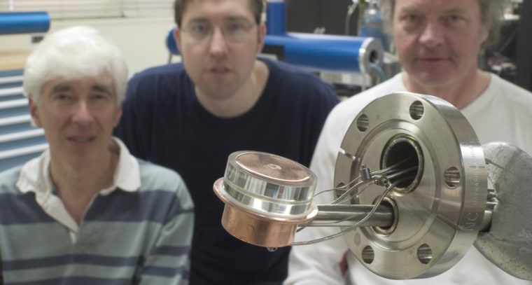 A key part of the apparatus for the nuclear fusion experiment is in the foreground. In the background are researchers Seth Putterman, Brian Naranjo and Jim Gimzewski.