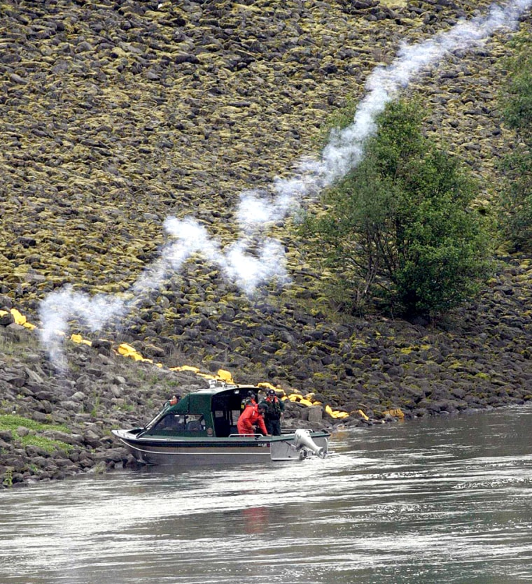 One of three boats shooting off firecrackers and noisemaking gunsas part ofa sea lion hazing experiment at Bonneville Dam.