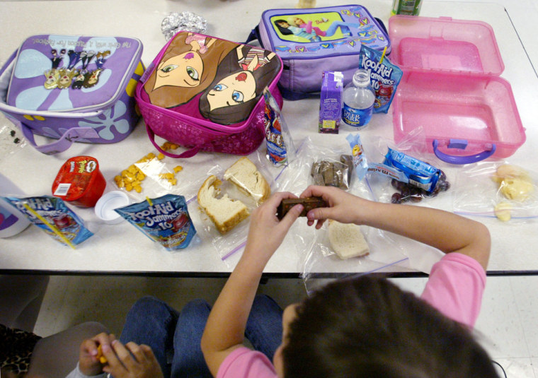 """Second graders at Hammond Elementary School in Laurel, Md., enjoy lunch break in the cafeteria on April 22. The school has adopted a program called """"Waste Free Wednesday,"""" which encourages students to become more aware of the amount of trash they are throwing away during lunches."""
