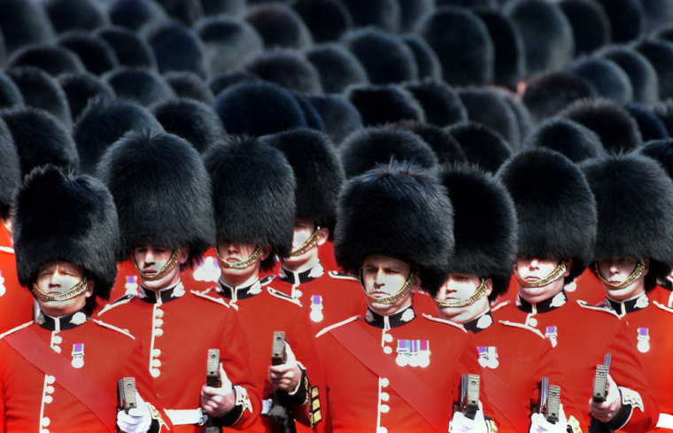 Scots Guards donning bearskin hatstake part in a royal procession in London in April, 2002.