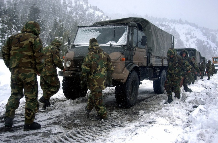 Chilean rescue workers prepare truck near Antuco volvano to search for missing soldiers in Andes, southeast of Santiago