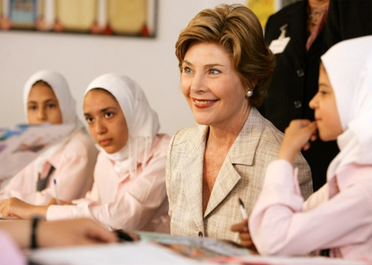 United States first lady Laura Bush sits down with students in Alexandria