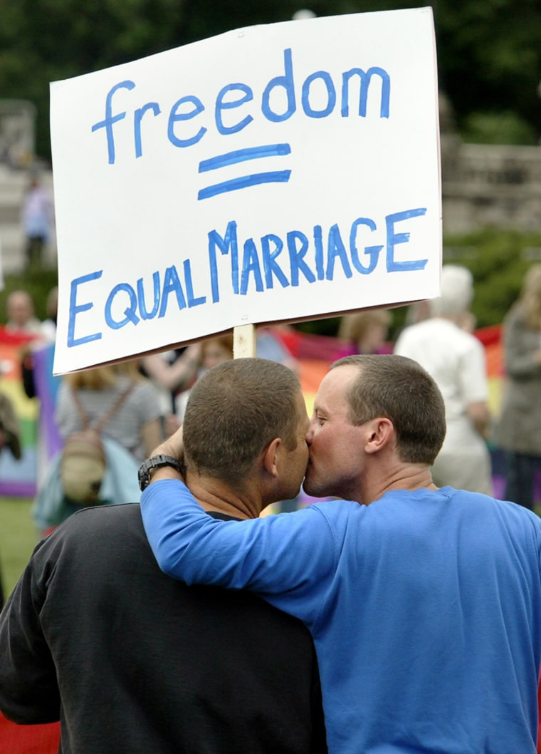 Alex, left, and his partner, Jason, take part in a rally for equal marriage on Parliament Hill in Ottawa, Canada, in this June 19 file photo. Canada on Tuesday became the third country to legalize same-sex marriage.
