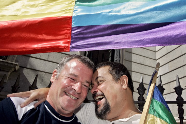 Supporters of gay marriage celebrate outside the Spanish Parliament, in Madrid, on Thursday.