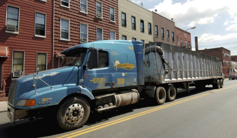 Each day, trains and trucks like this one in Brooklyncarry 50,000 tons of trash from New York to landfills and incinerators up to 650 miles away in rural towns and poorcities in New Jersey, Ohio, Pennsylvania, Virginia and South Carolina.