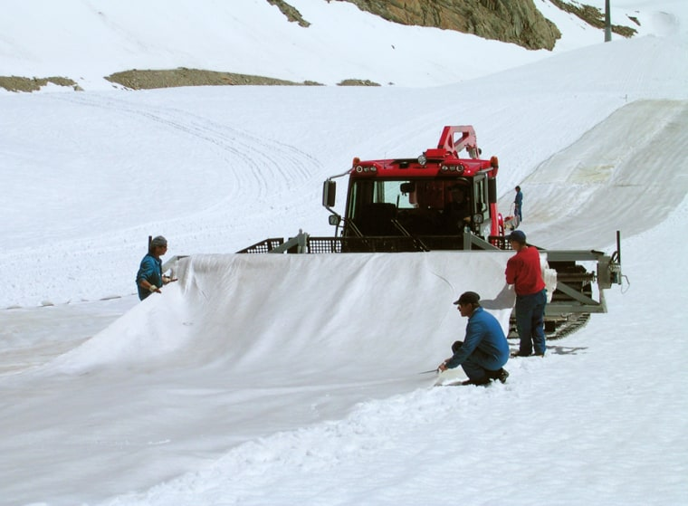Workers cover the ski slopes on the Pitztal Glacier in Austria with an innovative white fleece in an effort to protect the mountain from glacier melting.
