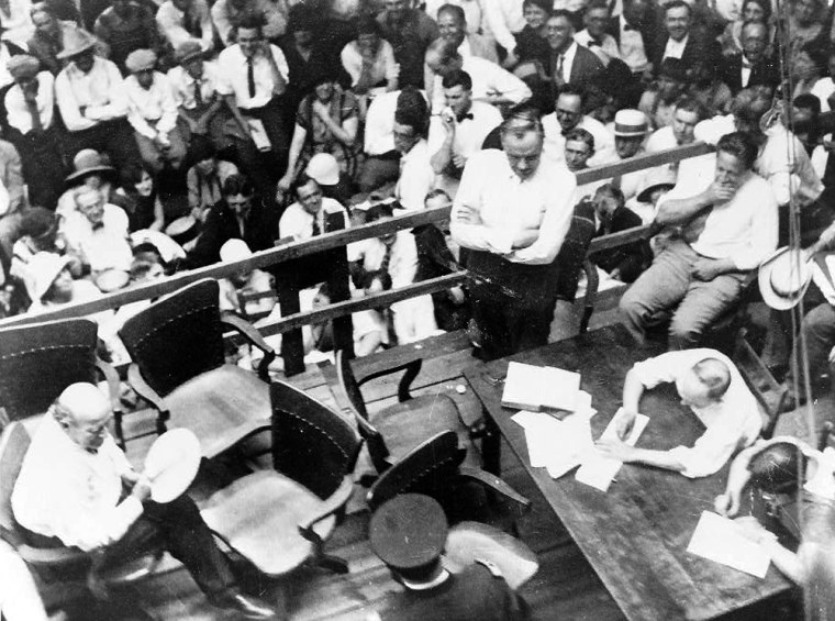 """Clarence Darrow, standing, examines William Jennings Bryan, seated at left, in the defining episode of the Scopes """"Monkey Trial"""" outside the Rhea County Courthouse in Dayton, Tenn."""