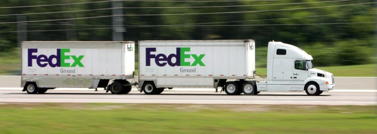 A FedEx Ground truck heads east on Interstate 24 in Nashville, Tenn. earlier this month. FedEx Ground drivers contend in a federal lawsuit they should be employees rather than independent contractors, a move that could cost the company millions.