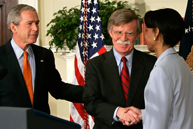 John Bolton (C) is congratulated by US S
