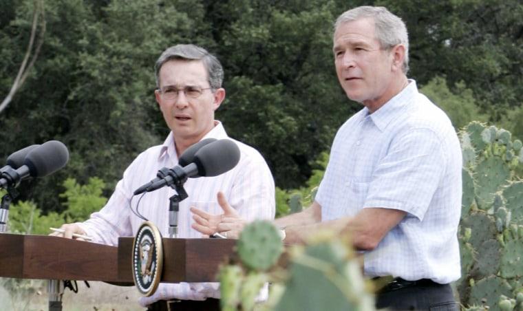 US President George W Bush talks next to Colombian President Alvaro Uribe in Texas
