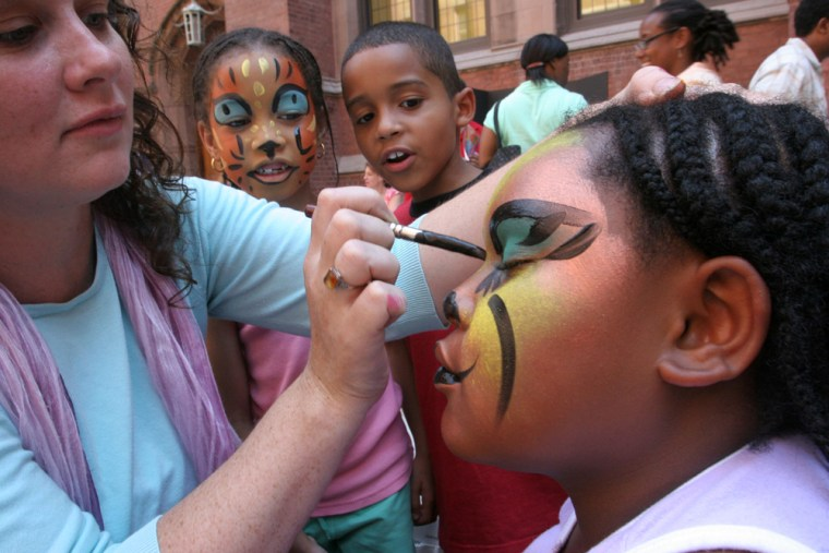 Jennifer Wade, left, paints the face of 8-year-old Jamillah Horton of New York at 4-H Family and Youth Day on July 20. 4-H and another group with roots in farming, the National FFA Organization, are reaching out to city kids with projects and hobbies often unrelated to agriculture.